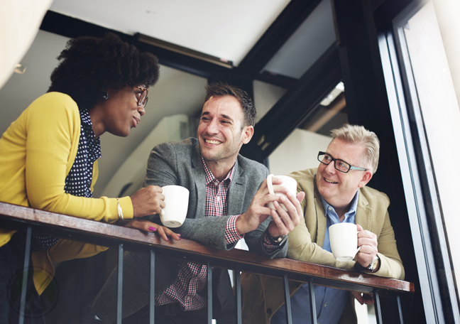 diverse office coworkers chatting over coffee