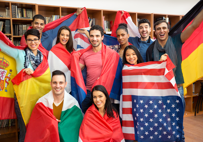diverse young people wearing international flags