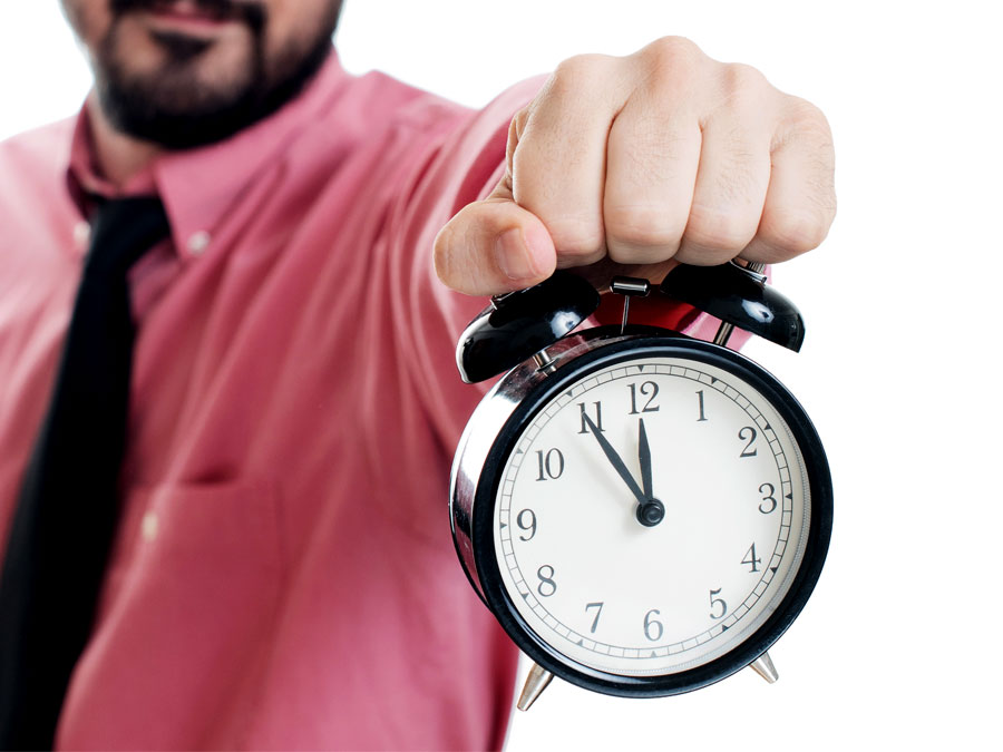 email support agent holding out alarm clock