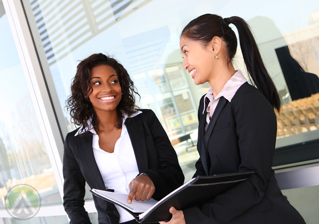 ethnic business women studying book reports
