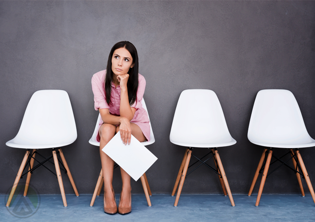 female job applicant sitting alone in waiting room