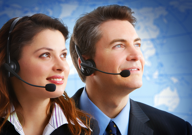male female call center agents looking away world map in background