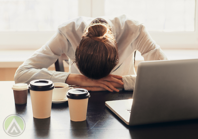office executive face down on laptop