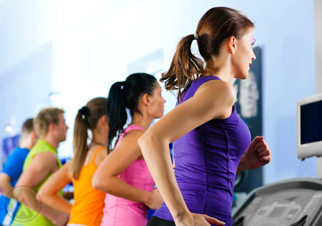 people in colorful gym clothes running on treadmill