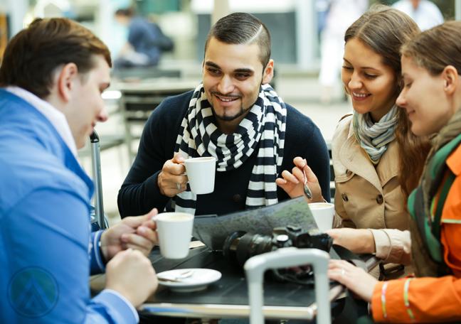 russian friends having coffee in cafe