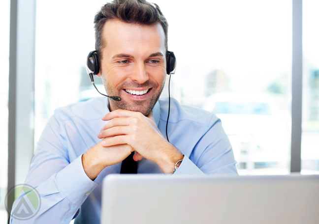 smiling customer service representative talking to customer on call
