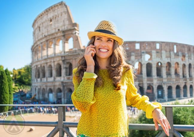 smiling tourist in phone call destination ancient stadium
