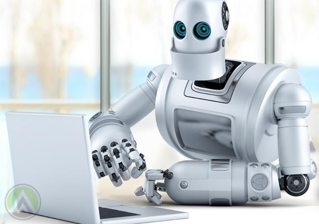 white robot using laptop computer
