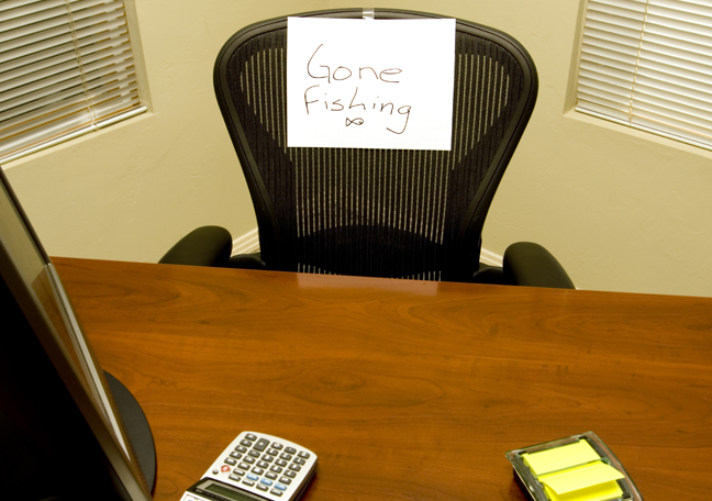 absent employee empty office chair sign gone fishing