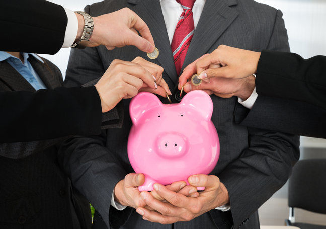 businessman holding pink piggybank employees dropping coins