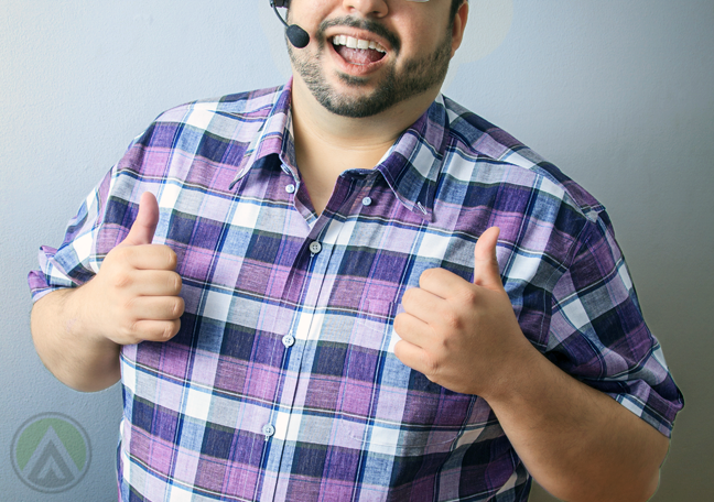 chubby bearded call center agent giving thumbs up