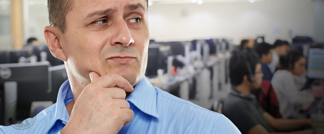 doubtful businessman looking at call center team