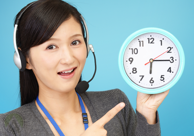 excited female call center agent pointing to clock