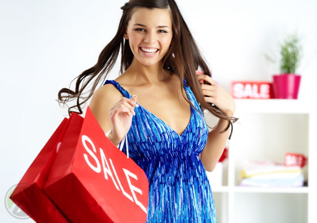excited woman with shopping bag at department store sale