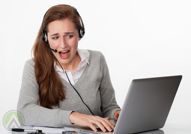 panicking call center employee using laptop
