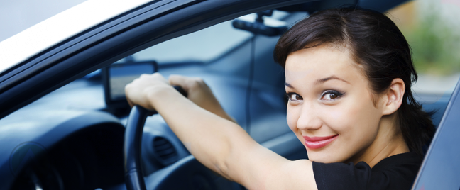 smiling female car driver
