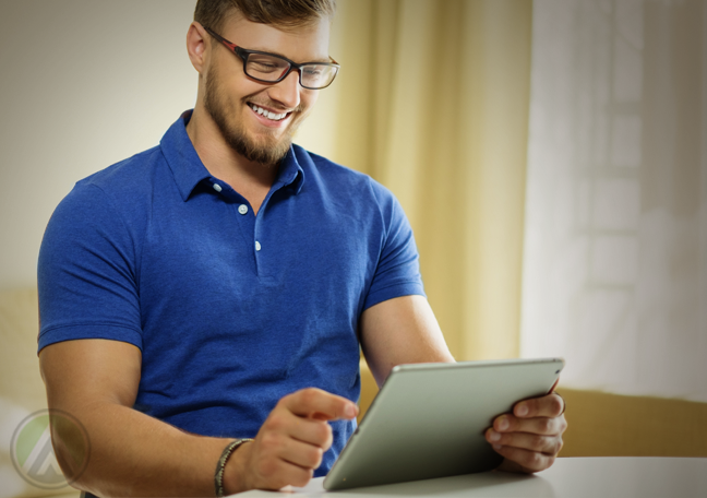 smiling man in glasses using tablet