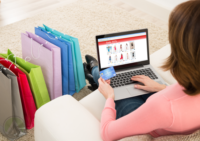 woman on shopping website on laptop