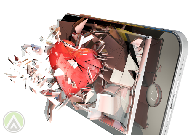 broken heart smashing through cracked smartphone screen