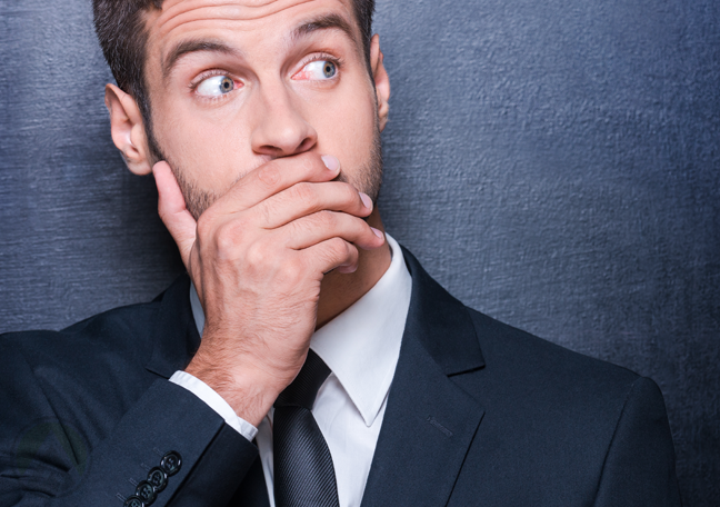 businessman covering mouth