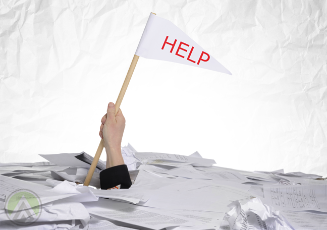 businessman drowning in paper holding up help white flag