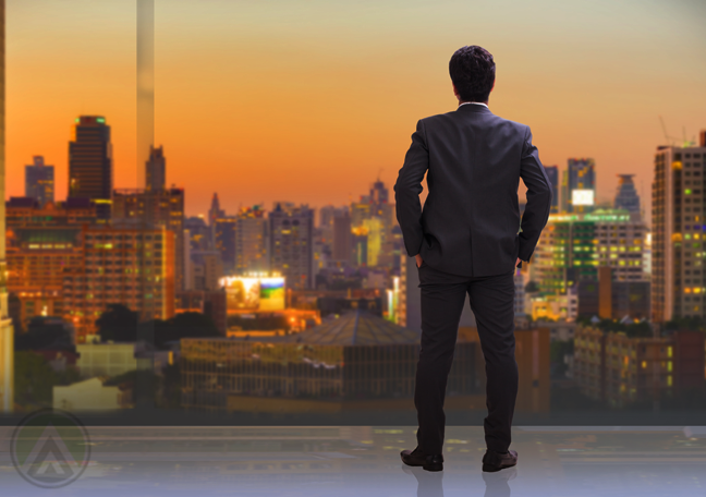 businessman looking over cityscape