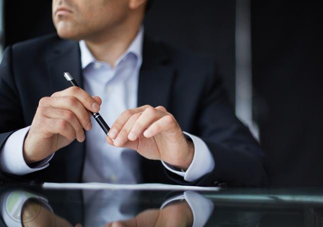businessman thinking holding pen