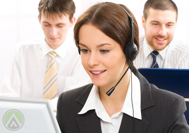call center agent attending to customer team in back