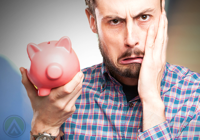 distraught office manager holding piggy bank