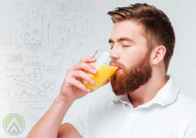 man drinking orange juice with number doodles
