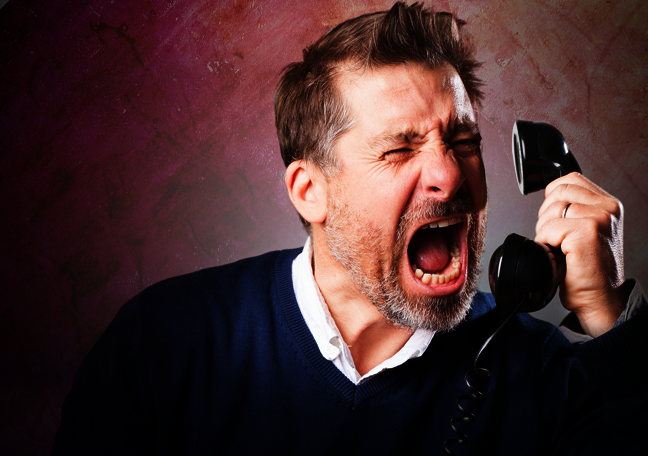 man in rage shouting over the phone