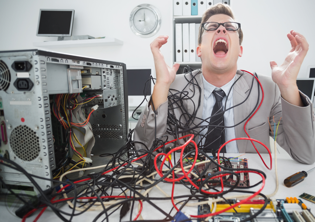 screaming tech worker in office fixing computer