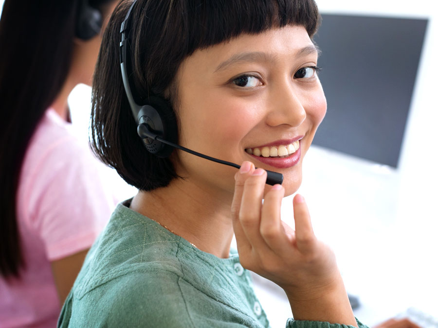 smiling call center agent helping a customer during a call