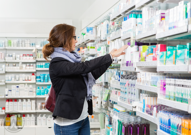 woman selecting products pharmacy