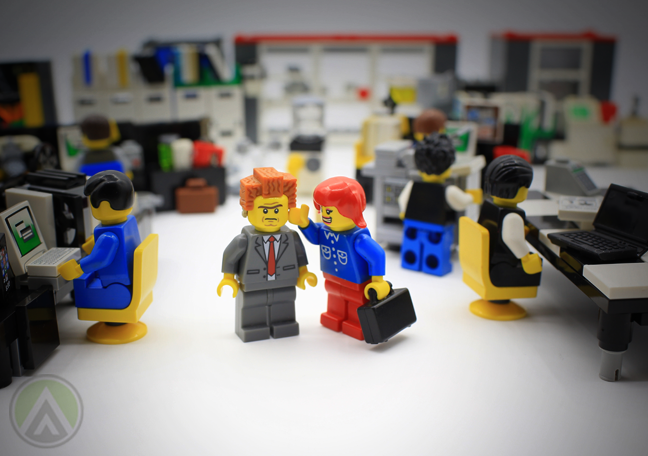 annoyed boss energetic employee lego minifigs in office
