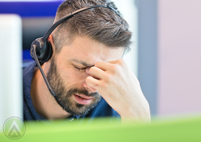 call center customer service worker headache stressed out