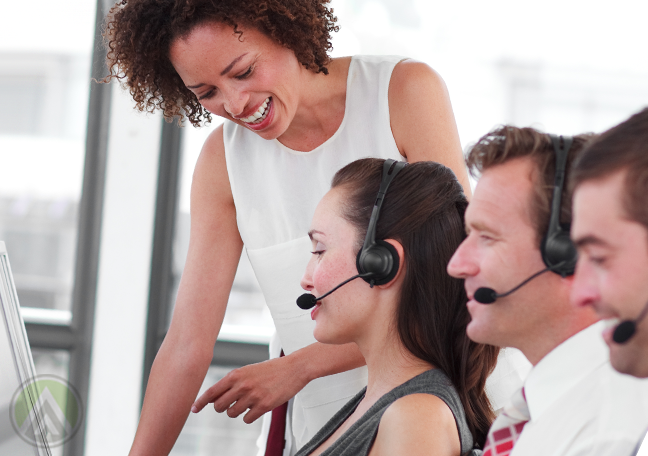 call center manager helping customer service agent