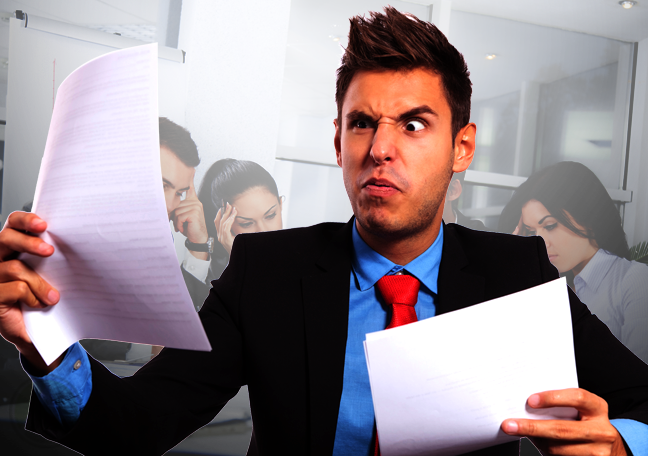 confused businessman reading printed report documents tired coworkers in background