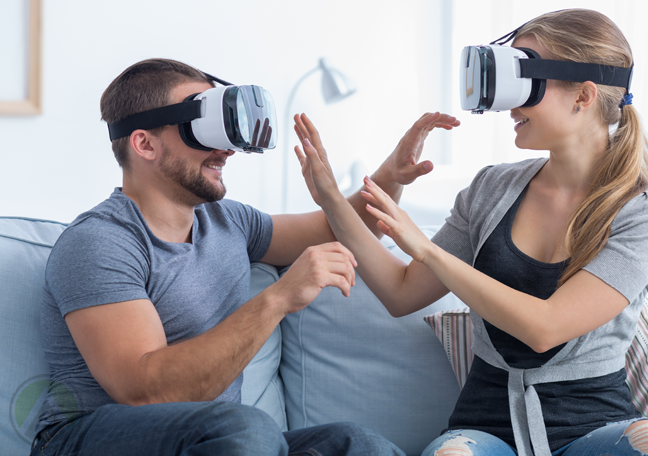 couple playing in couch wearing virtual reality vr glasses