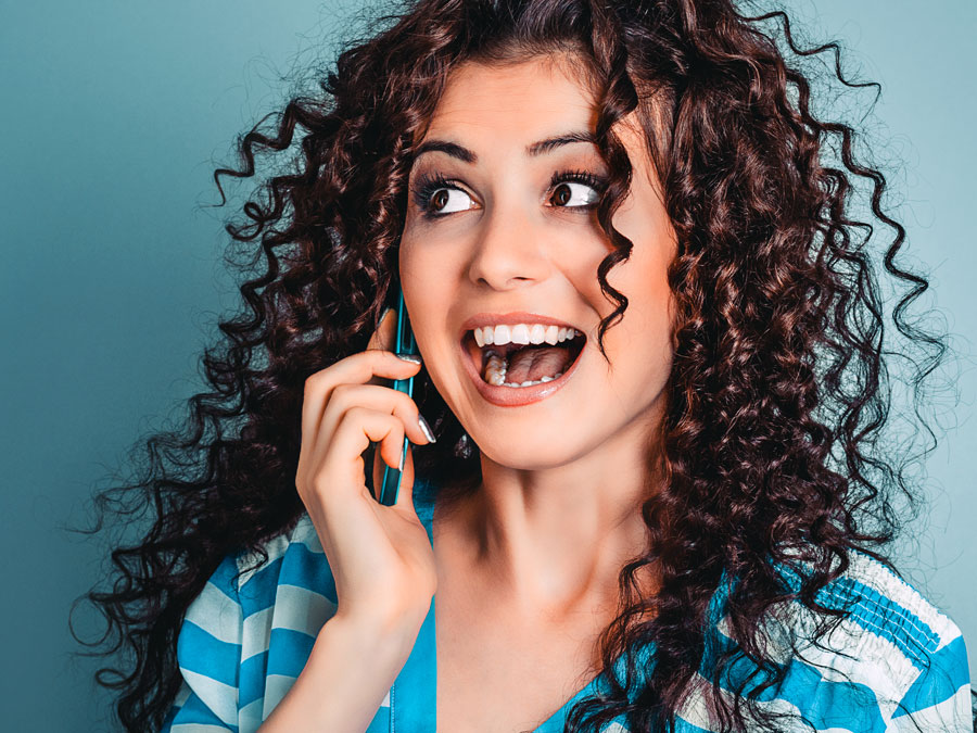 delightful excited woman speaking to customer service agent on the phone