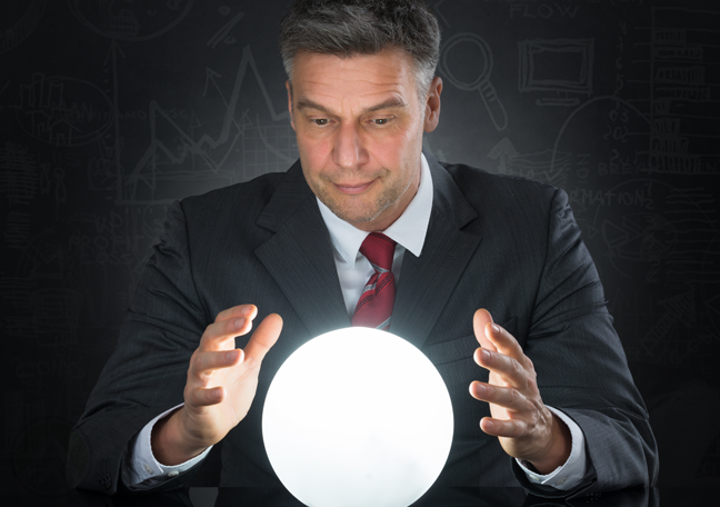 fortune teller businessman looking into crystal ball