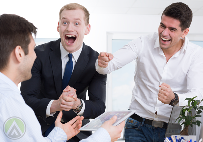 overjoyed businessman having fun with coworkers