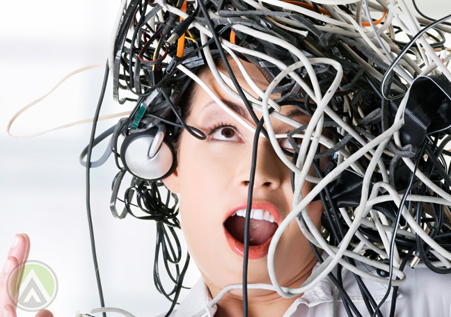 playful office employee tangled wires cable on head
