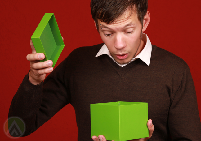 amused delighted man opening gift box