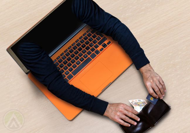 arms coming out of laptop screen stealing money from nearby wallet