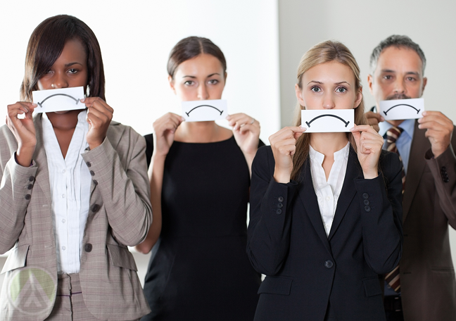 business team holding paper sad face to mouth