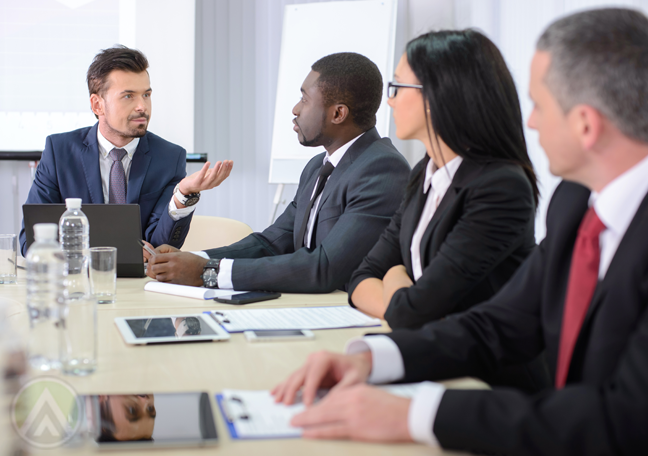 business team in meeting discussion lead by boss