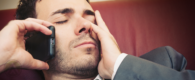businessman asleep making phone call