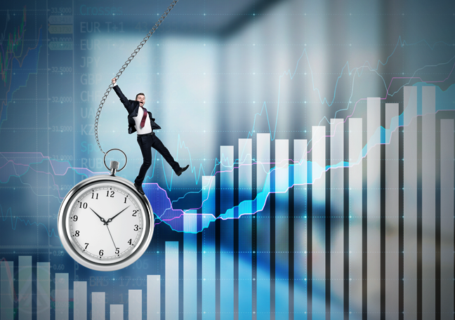 businessman dangling pocket watch over business report charts
