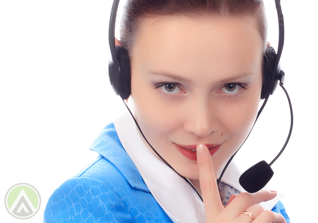 call center agent in blue with finger over mouth